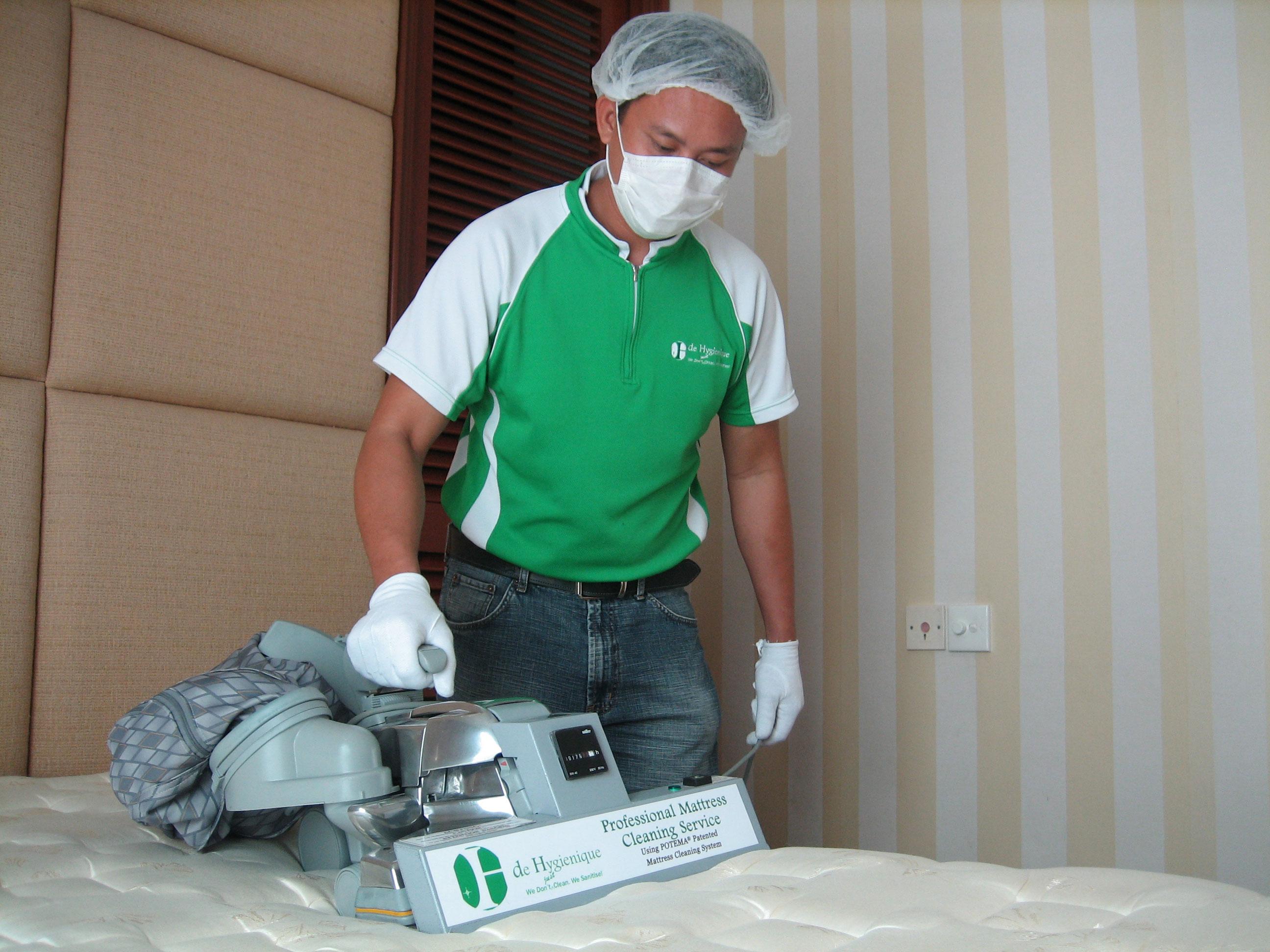 Staff deep cleaning a mattress