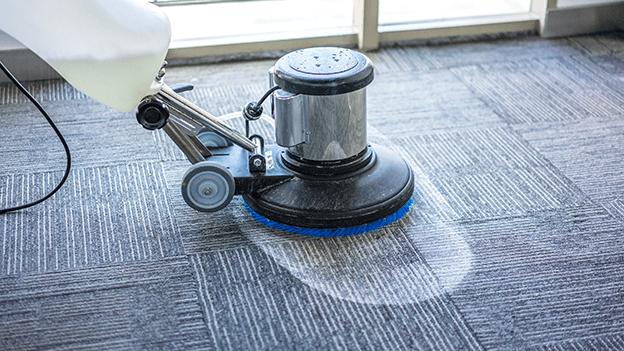 using machine to clean carpet