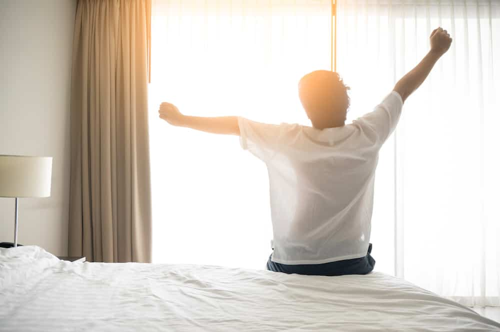 man waking up from mattress