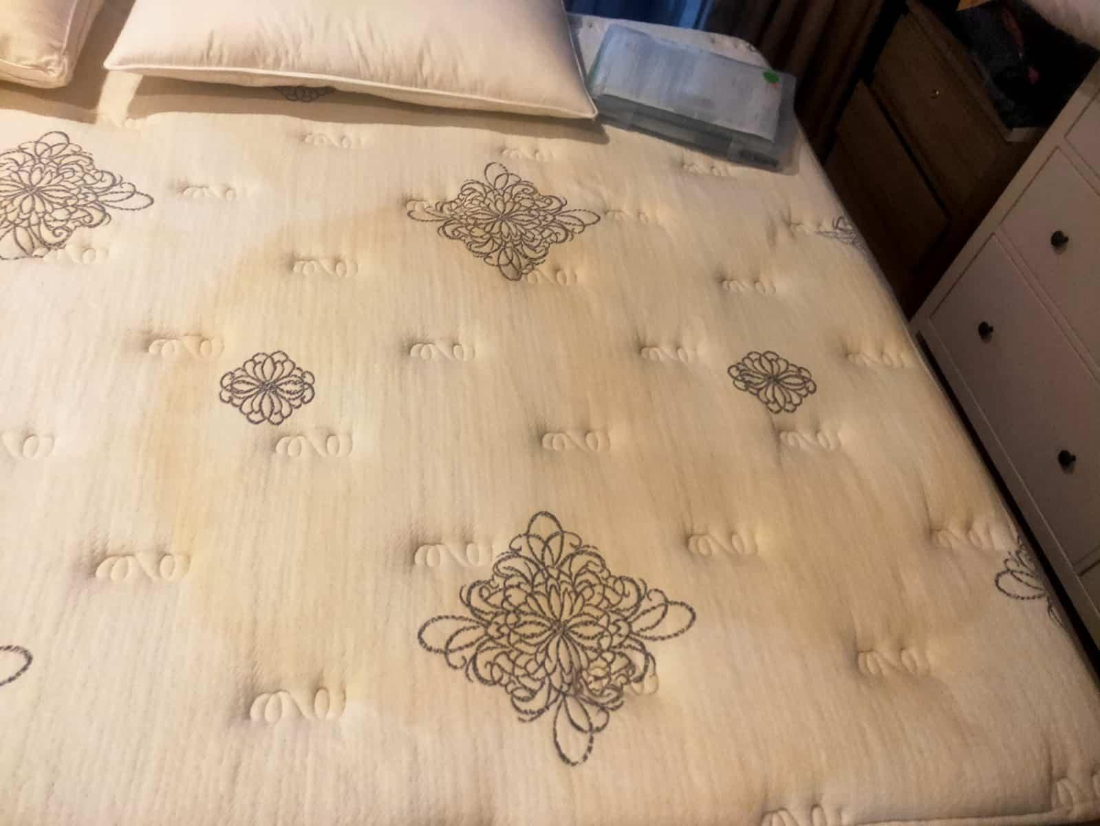 sweat stained yellow mattress