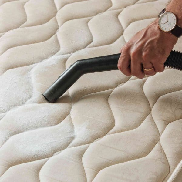 cleaning baking soda off mattress with a vacuum cleaner